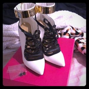 White black and gold heels